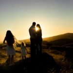 silhouette of family in a field